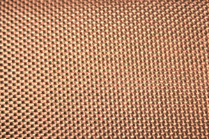 Flat. textured sample of bronze chemical etching element