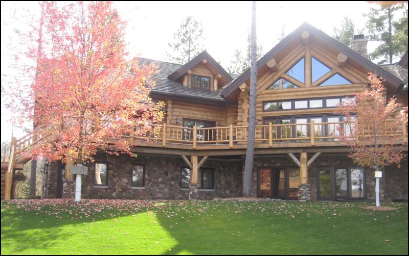 Luxury Log Home Wrap Around Deck luxury home builder
