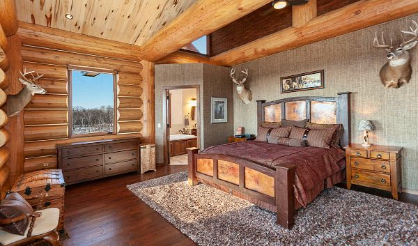 Log Home Bedroom Open Ceiling