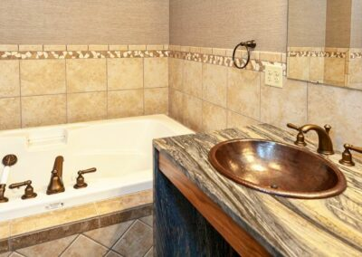 Copper Bathroom Sink And Stone Countertop