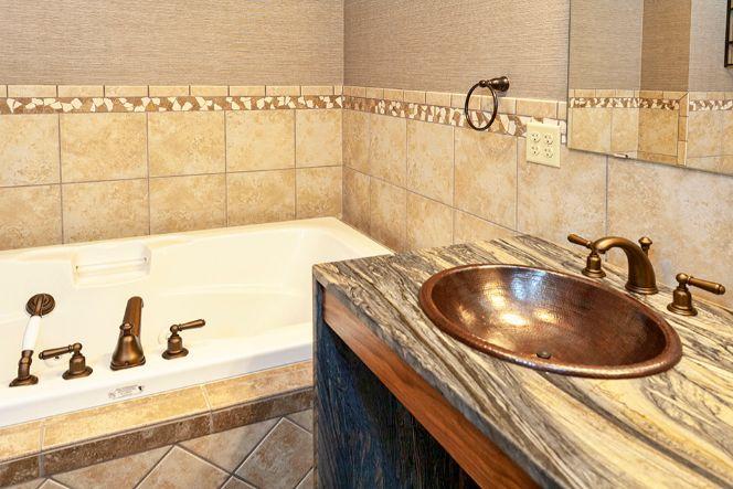 Copper Bathroom Sink And Stone Countertop