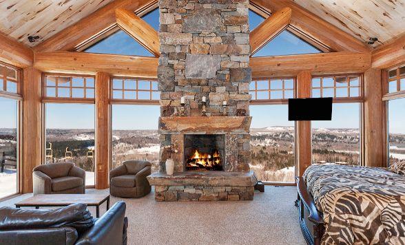 Custom Log Cabin Bedroom With Fireplace Windows