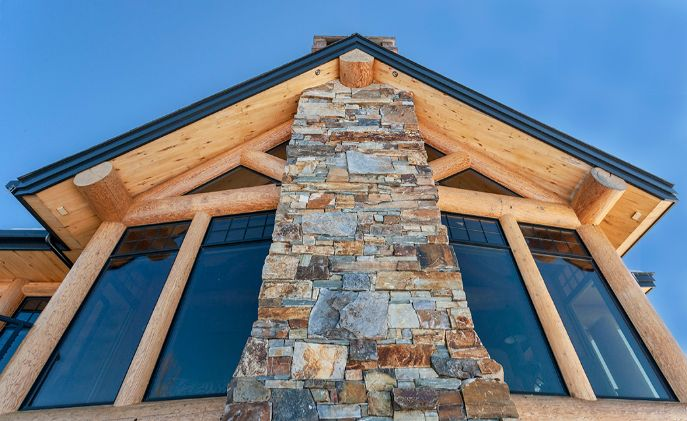 Hand Crafted Stone Fireplace Stack Exterior Detail