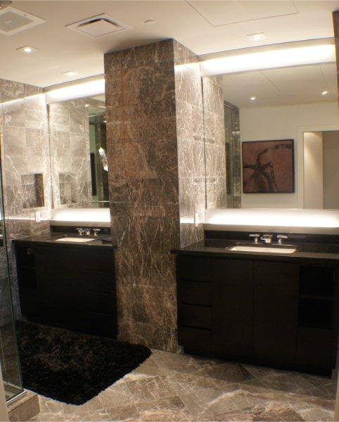 Beautiful Stone Walls Bathroom With Split Vanities