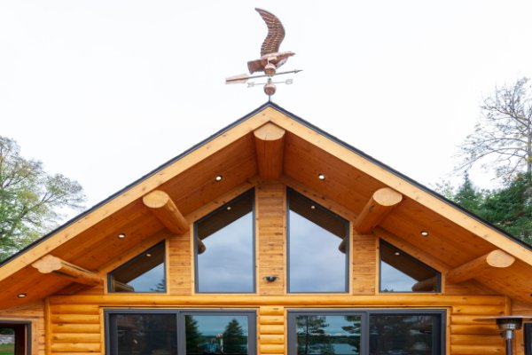 Log Home Roof Line With Weathervane