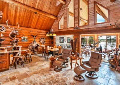 Magnificent Log Home Great Room With Game Trophies