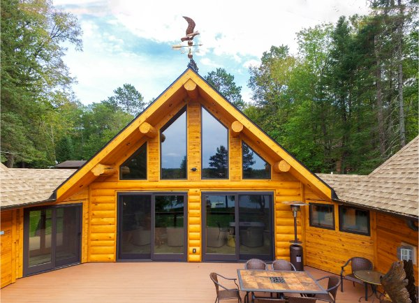 Massive Log Home Deck With Main Floor Access