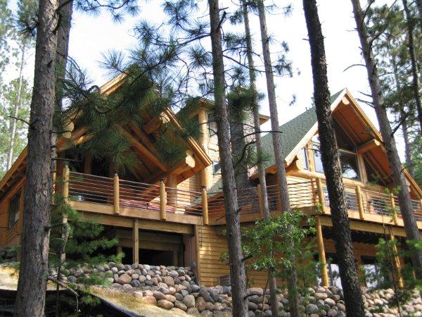 Towring Log Home Decks Overlooking Nature