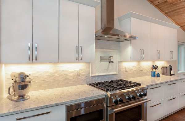 White Cabinets And White Stone Kitchen Remodel