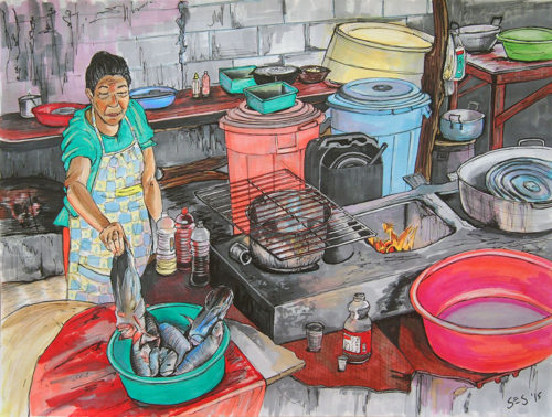 Woman frying fish in Suan, Colombia.