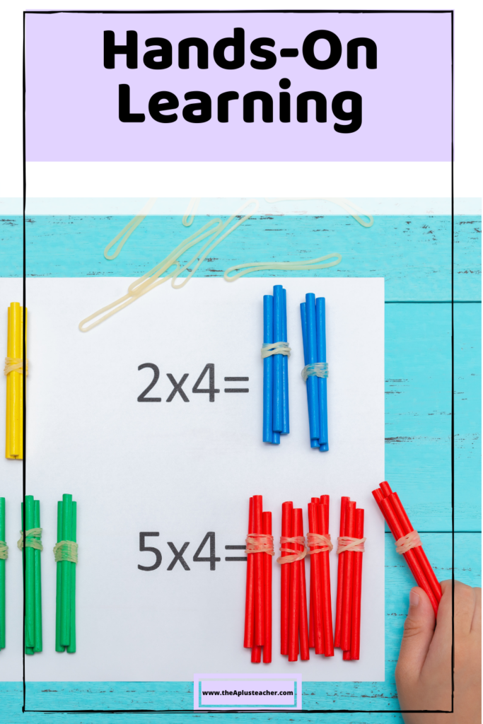title says hands-on learning and picture is of groups of sticks bundled together to represent hands-on math multiplication problems