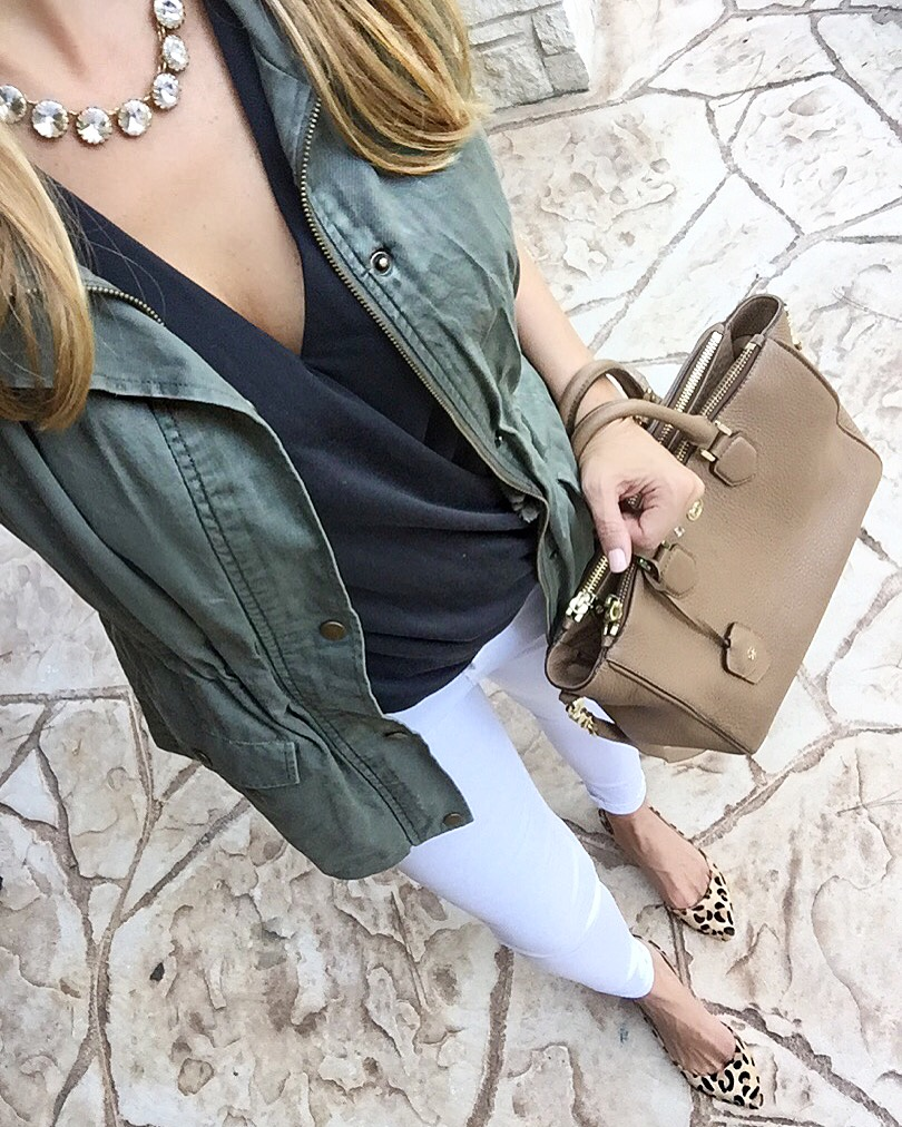 white jeans and military vest