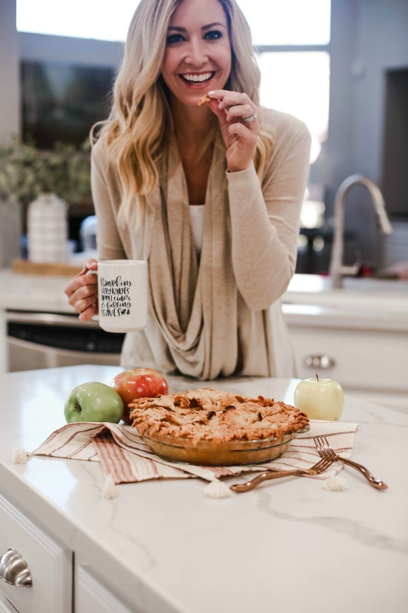 Fall | Thanksgiving | Recipes | Dessert | Mama Mary's Easy Apple Pie Recipe featured by top US lifestyle blog Haute & Humid |Easy Apple Pie Recipe by popular Houston lifestyle blog, Haute and Humid: image of a woman picking at a apple pie.