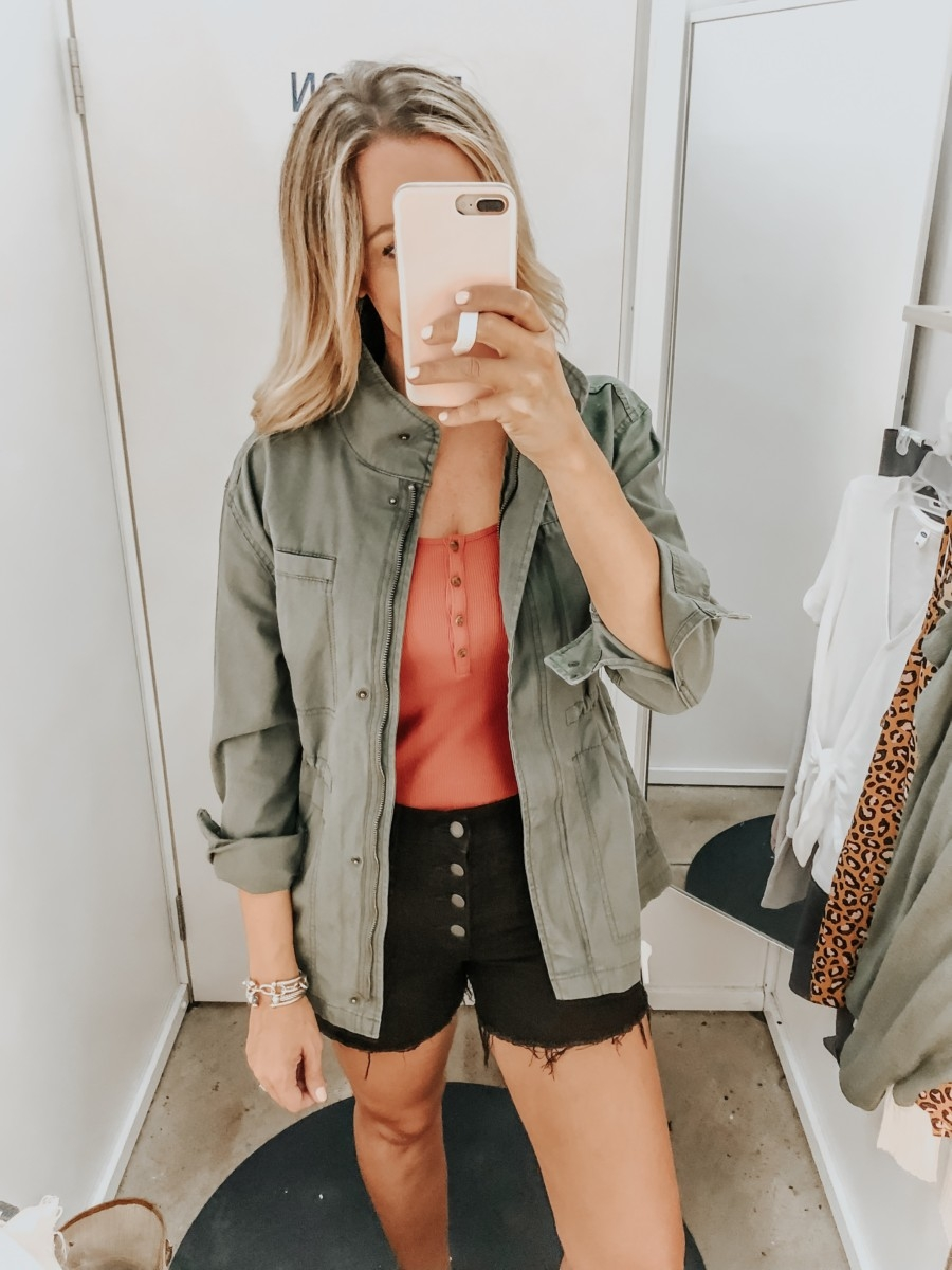 old navy try on | Old Navy Try On - August 2019 by popular Florida fashion blog, Haute and Humid: image of a woman standing in a Old Navy dressing room and wearing a Old Navy Tank, Canvas Utility Jacket and Old Navy High-Waisted Button-Fly Jean Cut-Offs.