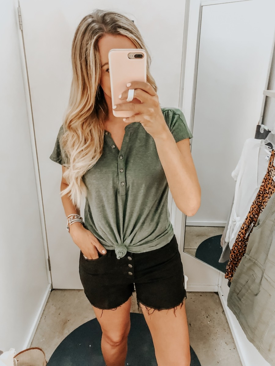 Old Navy Try On - August 2019 by popular Florida fashion blog, Haute and Humid: image of a woman standing in a Old Navy dressing room and wearing an Old Navy Linen-Blend Dolman-Sleeve Henley and Old Navy High-Waisted Button-Fly Jean Cut-Offs.