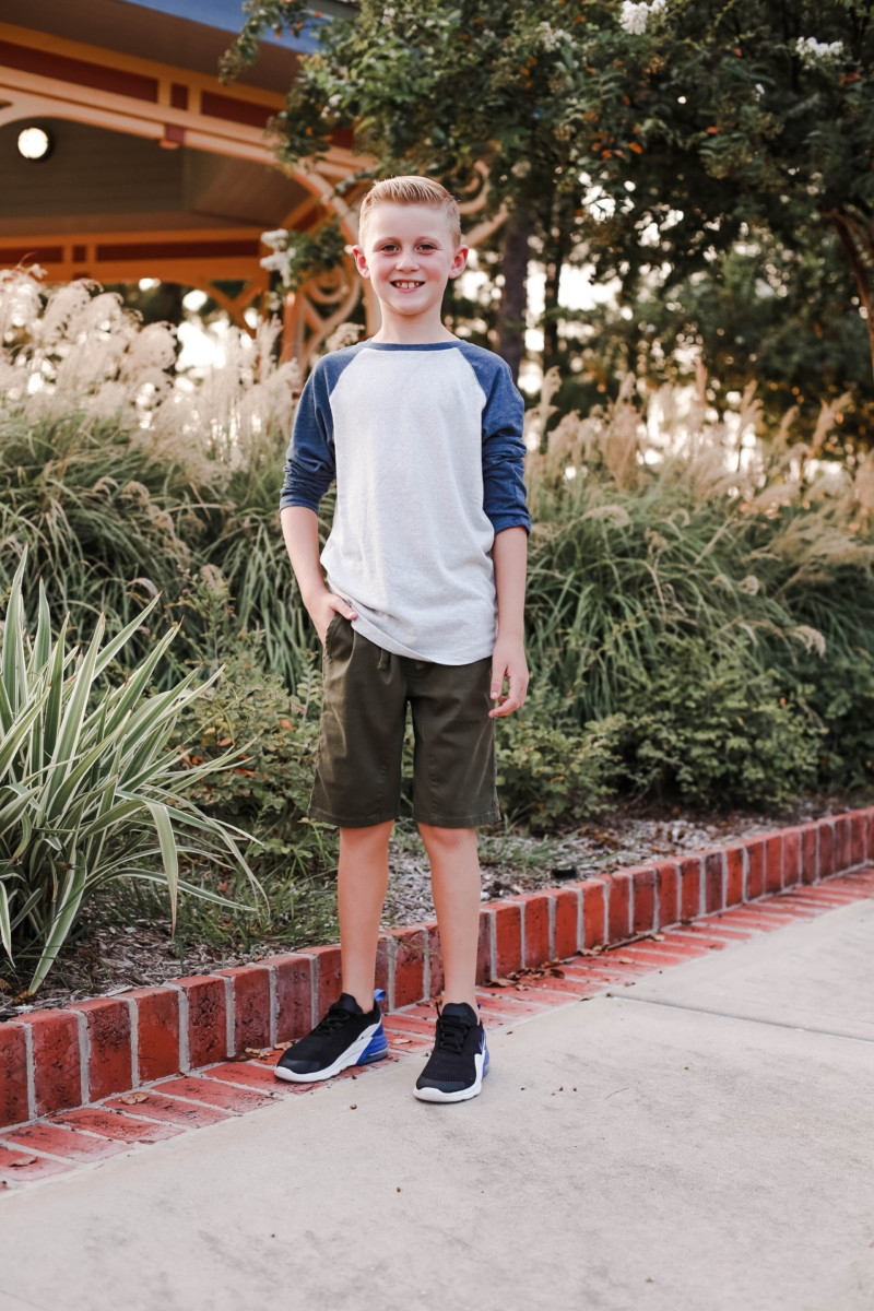 boys back to school clothes   How to Get to School on Time: 7 Easy Ways by popular Houston blog, Haute and Humid: image of a boy standing outside and wearing a Tucker and Tate Baseball T-Shirt, Tucker and Tate Knit Shorts, and Nike Free Run 5.0 Sneaker.