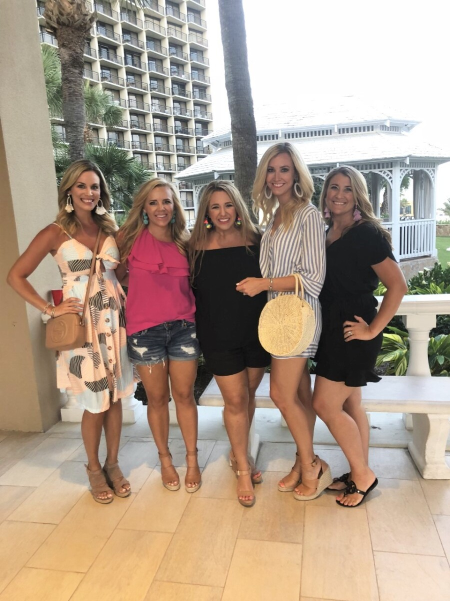 girls weekend in galveston | Galveston Travel Guide by popular Houston travel blog, Haute and Humid: image of group of women standing in the lobby of a Galveston, Texas hotel.