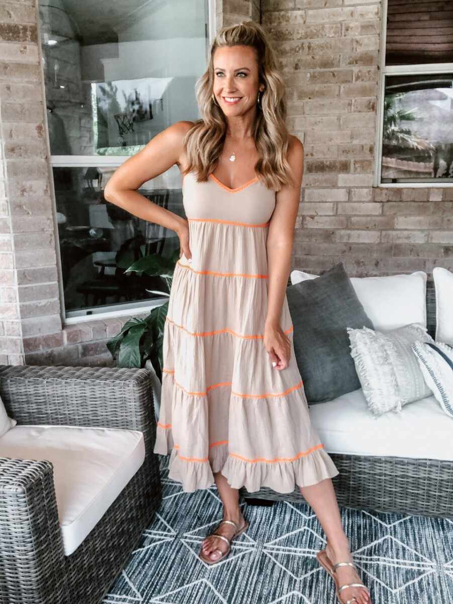Summer Wardrobe Essentials | Summer Style by popular Houston fashion blog, Haute and Humid: image of a woman sitting outside and wearing a Walmart Scoop Women's Ruffle Hem Tiered Neon Scallop Seamed Midi Dress and Walmart Scoop Women's Sofia Strappy Flat Sandals.