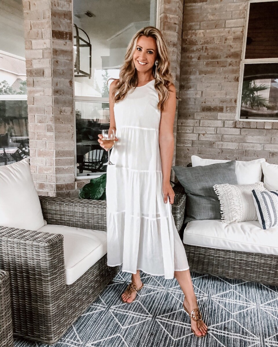 White Summer Dresses | White Summer Dresses by popular Houston fashion blog, Haute and Humid: image of a woman wearing a Target A New Day Women's Sleeveless Tiered Dress, Nordstrom Tory Burch sandals, and Amazon LEGITTA Raffia Tassel Rattan Hoop Drop Earrings.