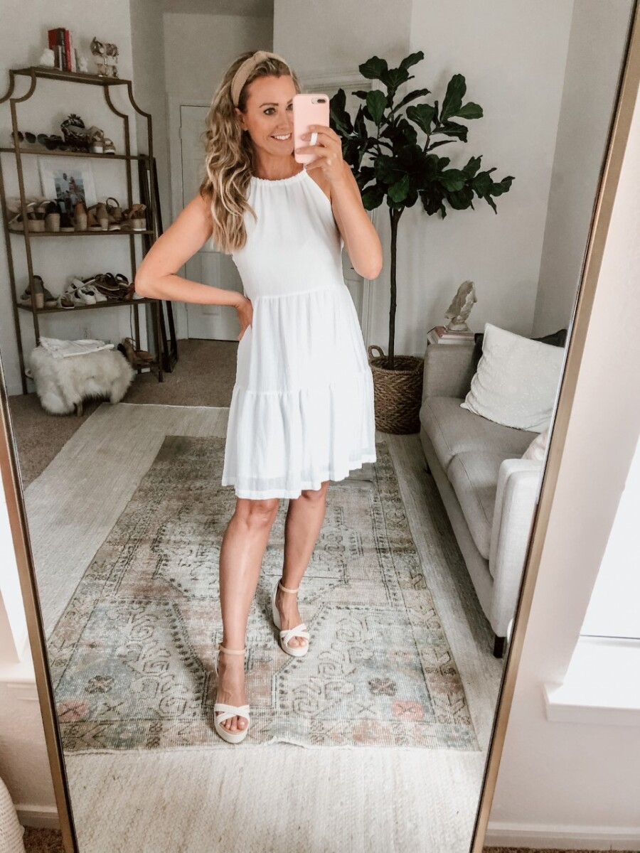 White Summer Dresses | White Summer Dresses by popular Houston fashion blog, Haute and Humid: image of a woman wearing a white halter dress, Nordstrom BP. Gabby Woven Wedge Sandal, and Amazon Funtopia knotted headband.