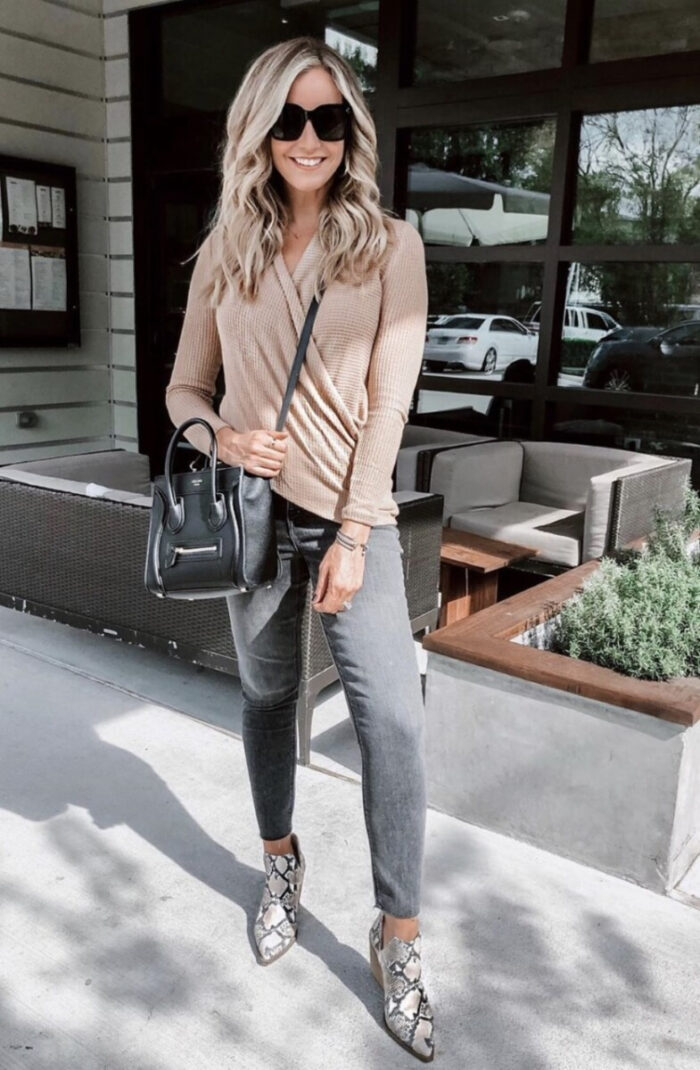 nordstrom anniversary sale 2020   Nordstrom Anniversary Sale by popular Houston life and style blog, Haute and Humid: image of a woman wearing a long sleeve tan top, black jeans, and snake print boots.