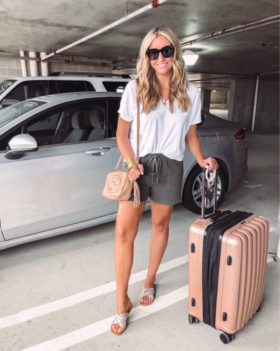 amazon finds under $50   Best Amazon Products by popular Houston life and style blog: image of a woman standing in a parking garage and wearing a white t-shirt and amazon cotton drawstring shorts.