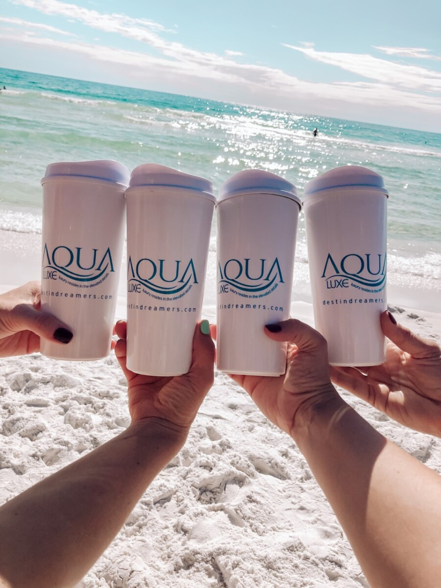 30a beach rentals |Florida Beach House Rental by popular Houston travel blog, Haute and Humid: image of four women holding Aqua Luxe cups.