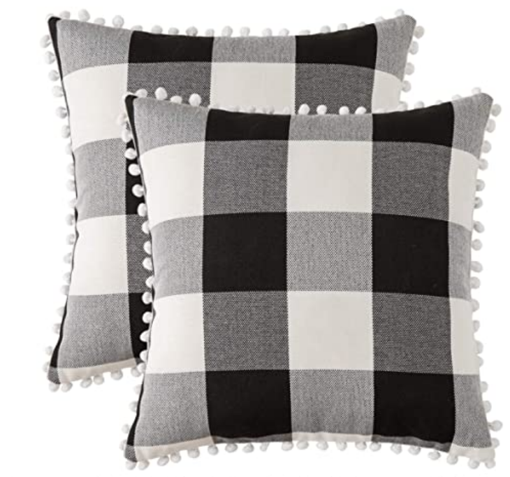 indoor outdoor pillow cover |Amazon Bestsellers by popular Houston life and style blog, Haute and Humid: image of a black and white buffalo plaid pompom pillow.