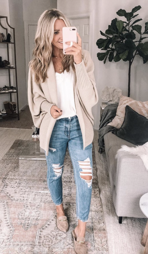 amazon cardigan |Amazon Bestsellers by popular Houston life and style blog, Haute and Humid: image of a woman wearing a cream cardigan, white cami, and distressed jeans.
