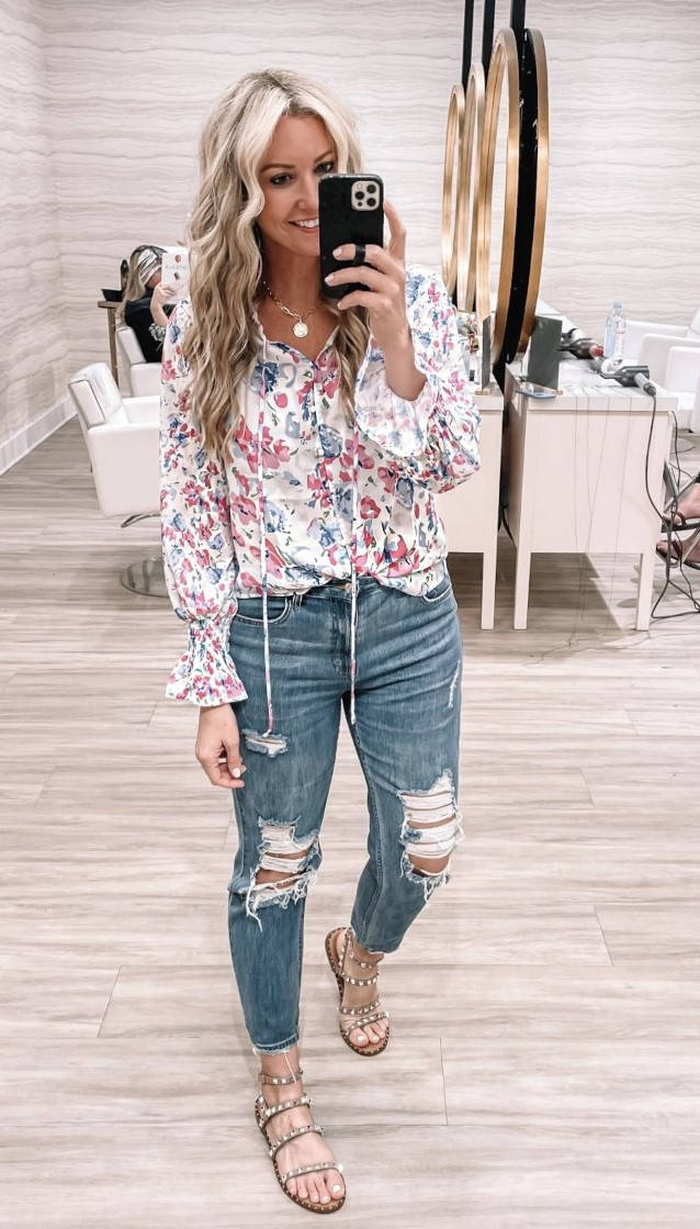 amazon spring tops  Amazon Favorites by Houston life and style blog, Haute and Humid: image of a woman wearing a Amazon floral top with a pair of distressed denim.