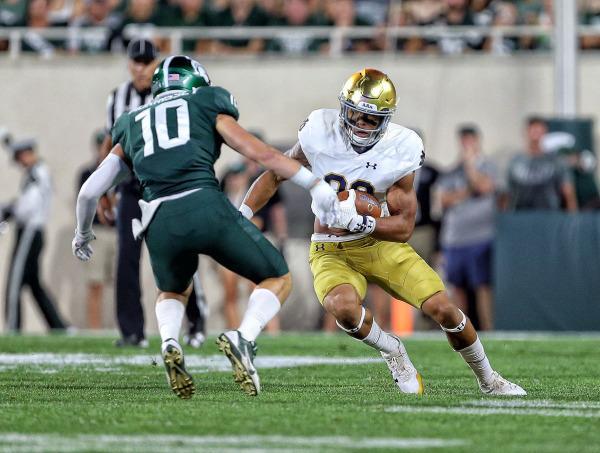 Josh Adams running the ball