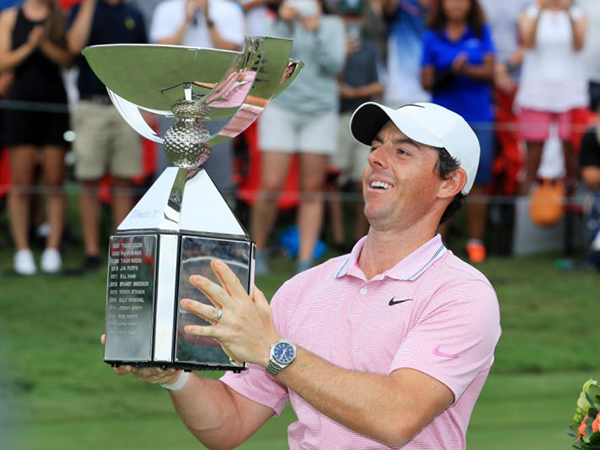 Rory McIlroy holding trophy