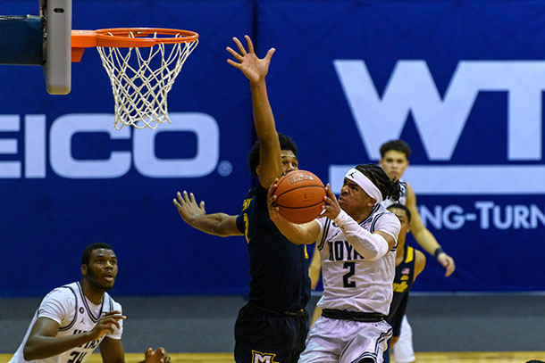 Dante Harris driving the ball to the basket against Marquette. Photo Credit: Rafael Suanes / Georgetown Athletics.