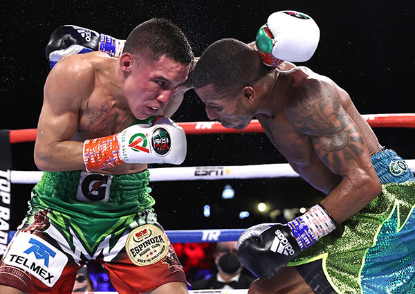 TUCSON, ARIZONA - SEPTEMBER 10: Oscar Valdez (L) and Robson Conceição (R) exchange punches during their fight for the WBC super featherweight championship