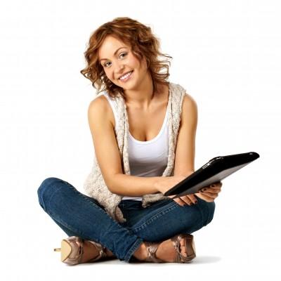 student holding laptop