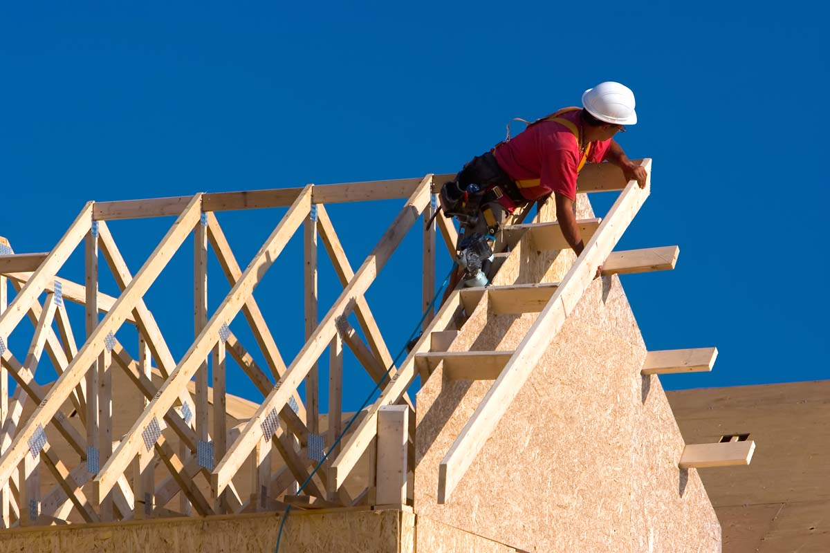 construction worker assembling roof beams