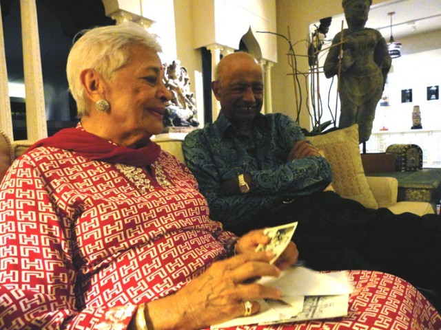 Indru Watumull and her husband Gulab Watumull leafing through photographs of Mukhi House in Hawai'i this summer. PHOTO: MAHIM MAHER/EXPRESS