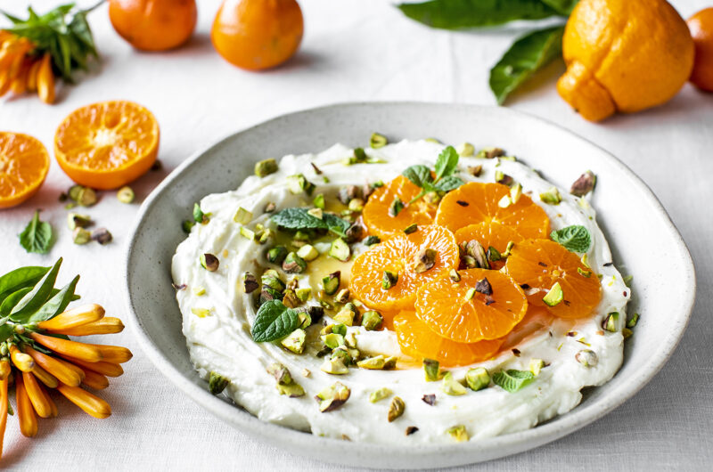 Easy homemade labneh cheese with honey, orange blossom water, pistachios and macerated mandarins.