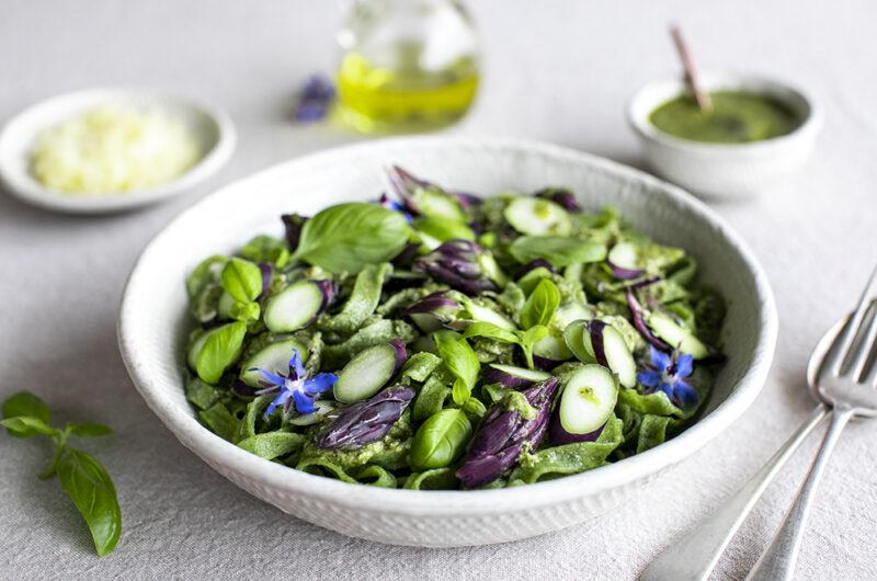 Homemade spinach pasta with macadamia pesto sauce and purple asparagus.