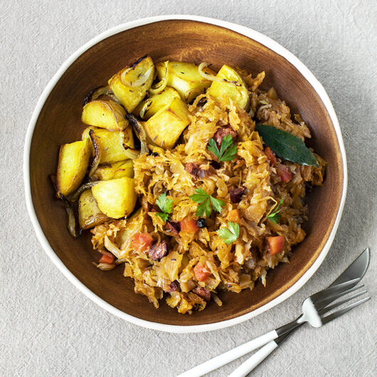 Sauerkraut and Chorizo Stew. Potatoes Fried with Caraway Seeds and Onion.