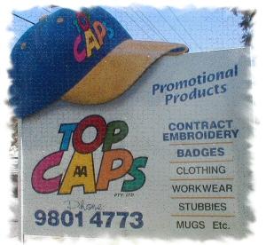 Top Caps Factory Signage