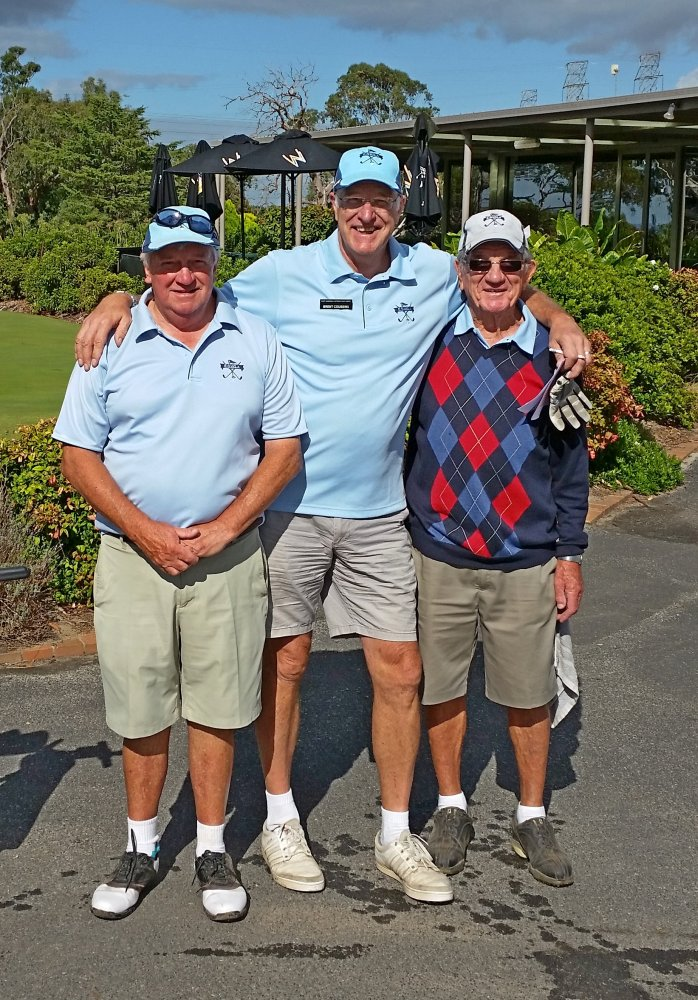 Neil Davis, Brent Coussins and Ken Steele resting before heading to the 1st tee.