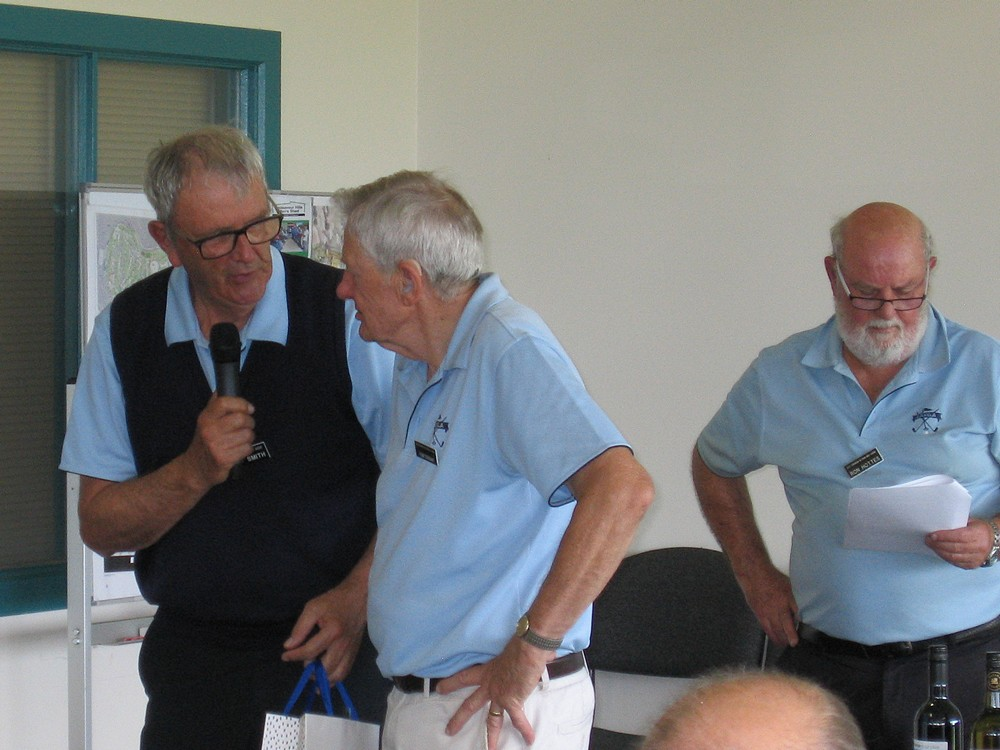 Barry Smith congratulates Tom Tarrant for his 21 years on Committee