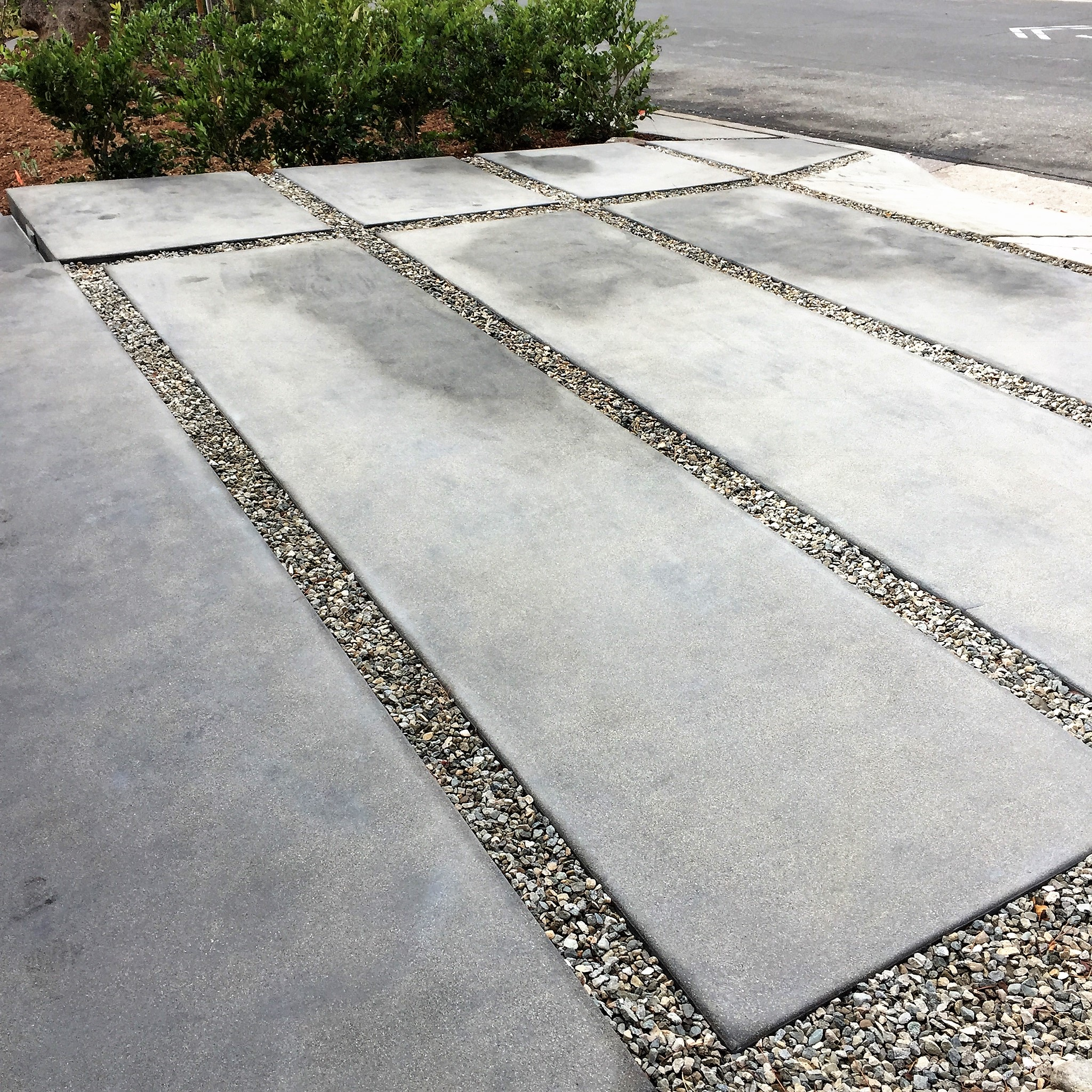 Ed's Landscaping Gray Concrete Slab Driveway Project