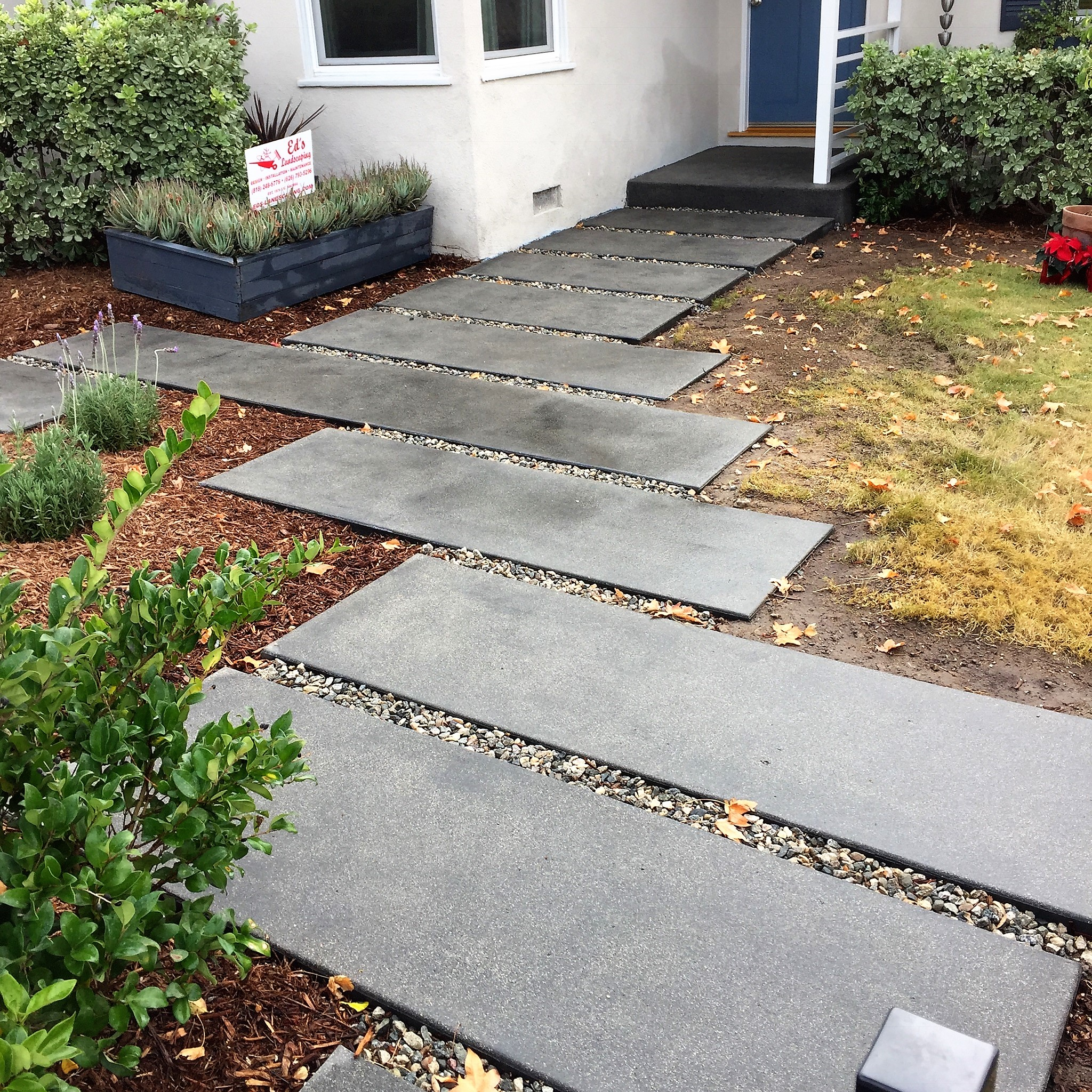 Ed's Landscaping Gray Slab concrete walkway
