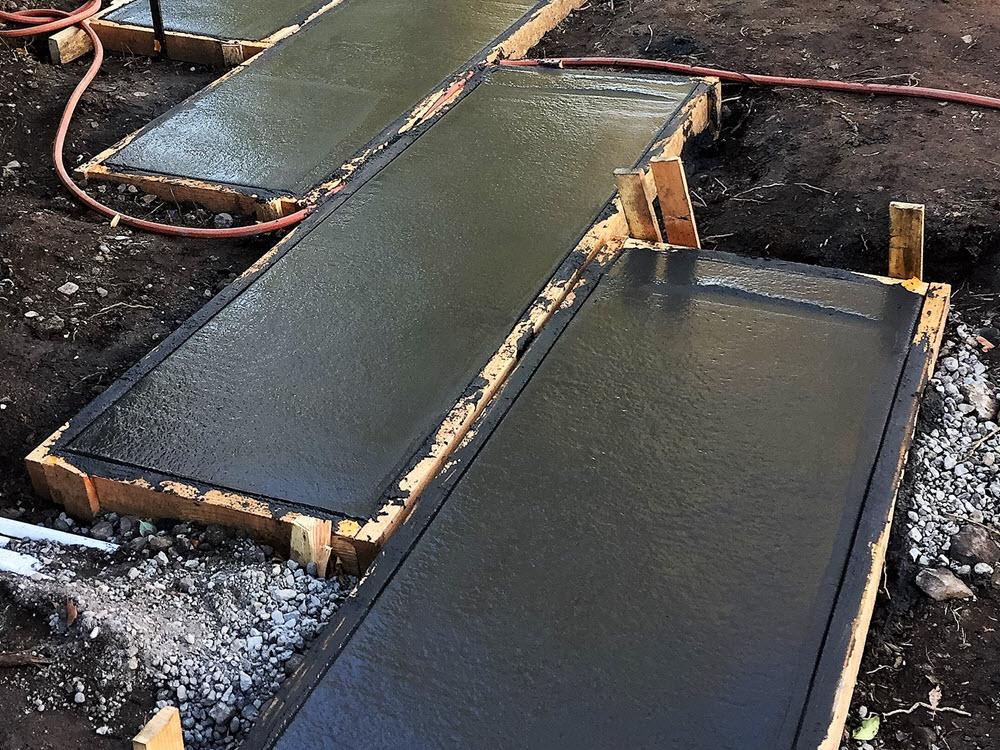 Ed's Landscaping black cement slab project underconstruction