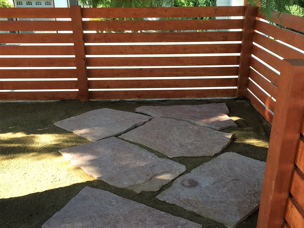 Ed's Landscaping horizontal fence with natural stone