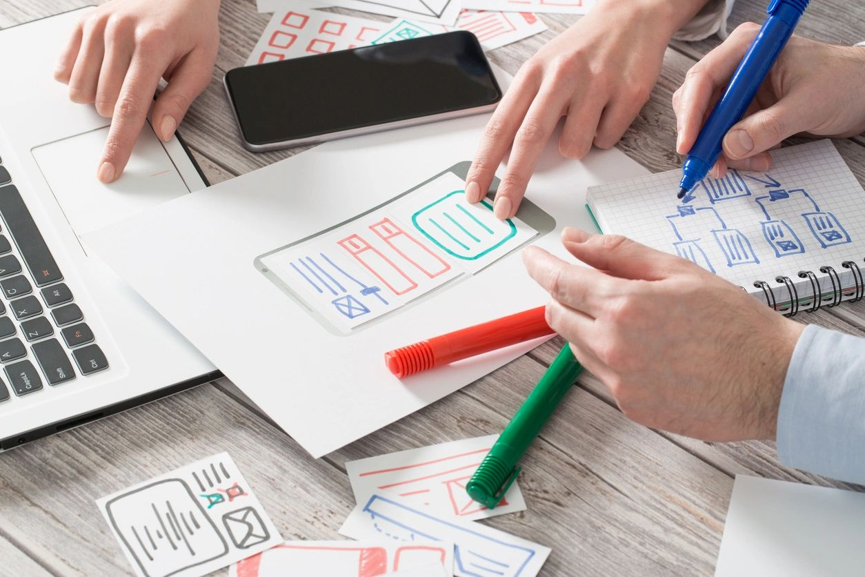 Web designers working on sketches