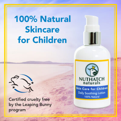 nuthatch naturals image of bottle with a beach as the background. 100% natural and cruelty free skin care for kids