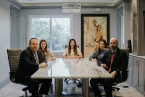 Anton Garcia Law Team in Tampa at Conference Table